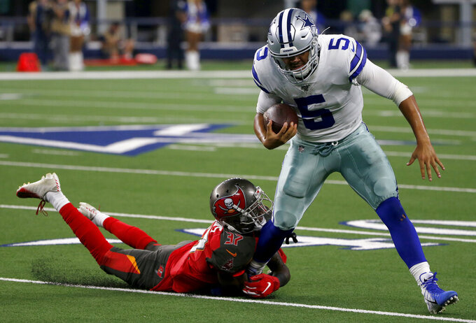 Tampa Bay Buccaneers cornerback Mazzi Wilkins (37) stops Dallas Cowboys quarterback Taryn Christion (5) from gaining yardage in the second half of a preseason NFL football game in Arlington, Texas, Thursday, Aug. 29, 2019. (AP Photo/Michael Ainsworth)