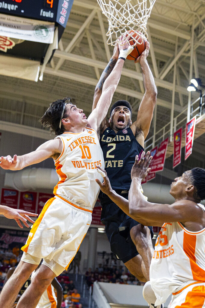 Tennessee forward John Fulkerson (10) blocks a shot by Florida State guard Anthony Polite (2) in the second half of an NCAA college basketball game at the Emerald Coast Classic in Niceville, Fla., Friday, Nov. 29, 2019. (AP Photo/Mark Wallheiser)