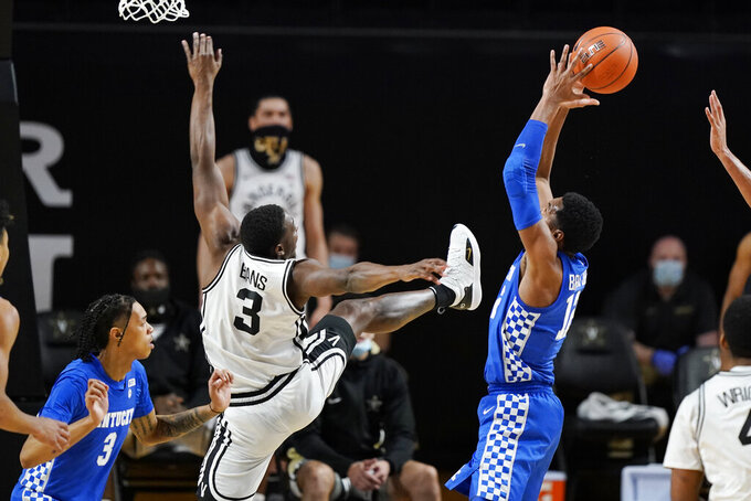 Kentucky forward Keion Brooks Jr. (12) grabs a rebound from Vanderbilt guard Maxwell Evans (3) in the second half of an NCAA college basketball game Wednesday, Feb. 17, 2021, in Nashville, Tenn. (AP Photo/Mark Humphrey)