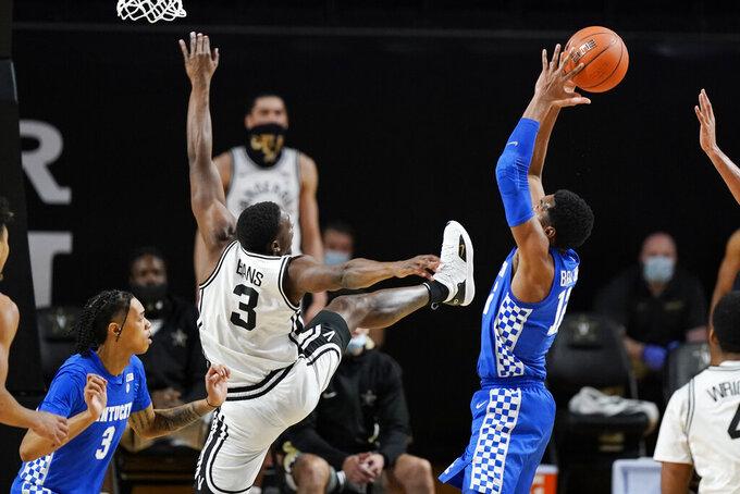 Kentucky forward Keion Brooks Jr. (12) grabs a rebound from Vanderbilt guard Maxwell Evans (3) in the second half of an NCAA college basketball game Wednesday, Feb. 17, 2021, in Nashville, Tenn. (AP Photo/Mark Humphrey)