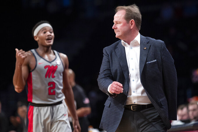 Mississippi guard Devontae Shuler (2) talks to head coach Kermit Davis during the first half of an NCAA college basketball game against Oklahoma State in the final of the NIT Season Tip-Off tournament, Friday, Nov. 29, 2019, in New York. (AP Photo/Mary Altaffer)