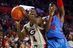 Georgia's Tyree Crump (4) looks to shoot while defended by Mississippi guard Bryce Williams (13) during an NCAA college basketball game in Athens, Ga., Saturday, Jan. 25, 2020. (Joshua L. Jones/Athens Banner-Herald via AP)