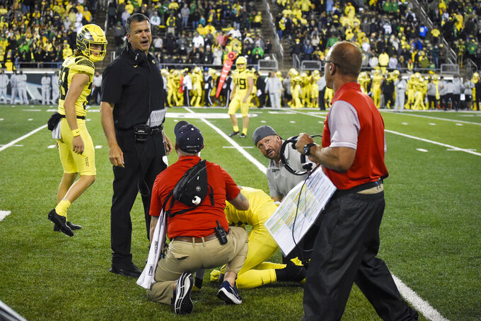 Oregon head coach Mario Cristobal and Stony Brook head coach Chuck Priore exchange words during the fourth quarter of an NCAA college football game Saturday, Sept. 18, 2021, in Eugene, Ore. (AP Photo/Andy Nelson)