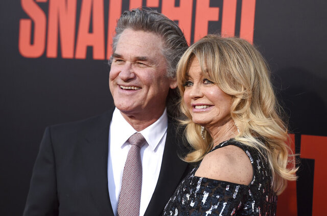 FILE - Kurt Russell, left, and Goldie Hawn appear at the premiere of Hawn's film,