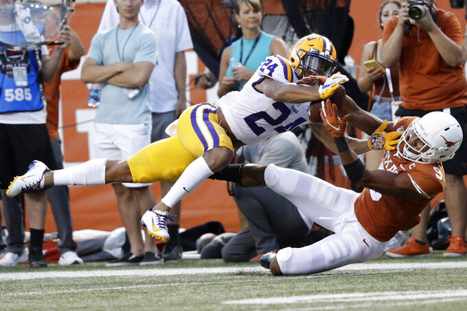 FILE - In this Sept. 7, 2019, file photo, LSU cornerback Derek Stingley Jr., left, breaks up a pass intended for Texas wide receiver Collin Johnson during the first half of an NCAA college football game, in Austin, Texas. Stingley was selected as newcomer of the year on The Associated Press All-Southeastern Conference football team, Monday, Dec. 9, 2019. (AP Photo/Eric Gay, File)