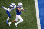 Kansas tight end James Sosinski (82) is chased into the end zone by Indiana State defensive back Hameed Oyedele (10) to score a touchdown during the second half of an NCAA college football game Saturday, Aug. 31, 2019, in Lawrence, Kan. Kansas won 24-17. (AP Photo/Charlie Riedel)