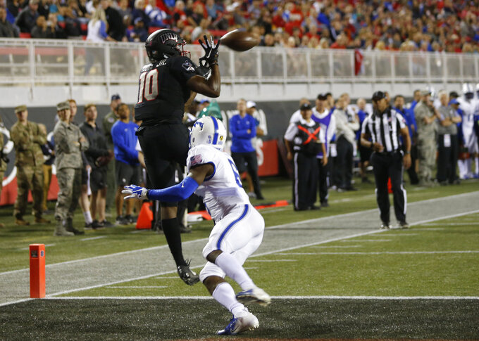 UNLV wide receiver Darren Woods Jr. (10) pulls in a touchdown pass over Air Force defensive back Zane Lewis (6) during the first half of an NCAA college football game in Las Vegas, Friday, Oct. 19, 2018. (Steve Marcus/Las Vegas Sun via AP)