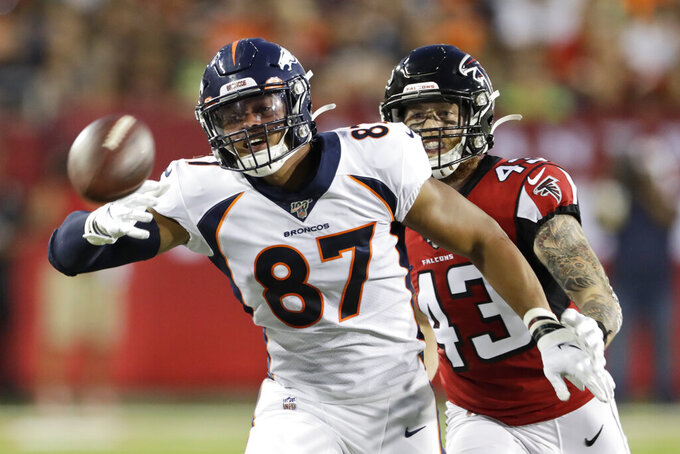Denver Broncos tight end Noah Fant (87) reaches for an overthrown pass under pressure from Atlanta Falcons defensive back Parker Baldwin (43) during the first half of the Pro Football Hall of Fame NFL preseason game Thursday, Aug. 1, 2019, in Canton, Ohio. (AP Photo/Ron Schwane)