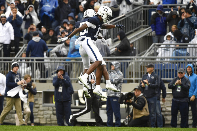 Penn State wide receiver KeAndre Lambert-Smith (13) celebrates with Jahan Dotson (5) after catching a first quarter touchdown pass against Illinois during an NCAA college football game in State College, Pa., Saturday, Oct. 23, 2021. (AP Photo/Barry Reeger)