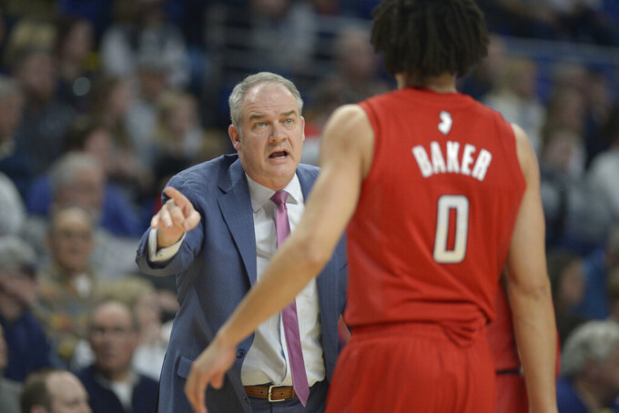 Rutgers coach Steve Pikiell gives some instructions to Geo Baker (0) during the first half of an NCAA college basketball game against Penn State, Wednesday, Feb. 26, 2020, in State College, Pa. (AP Photo/Gary M. Baranec)