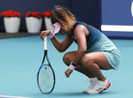 Naomi Osaka, of Japan, kneels on the court during her match against Hsieh Su-Wei, of Taiwan, during the Miami Open tennis tournament, Saturday, March 23, 2019, in Miami Gardens, Fla. (AP Photo/Lynne Sladky)