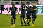 New York City FC defender Anton Tinnerholm, right, is congratulated by Sebastien Ibeagha (33) after scoring a goal during the first half of an MLS soccer match against Inter Miami, Saturday, Oct. 3, 2020, in Fort Lauderdale, Fla. (AP Photo/Lynne Sladky)