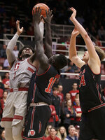 Stanford guard Daejon Davis, left, shoots against Utah forward Both Gach (11) and center Jayce Johnson (34) during the second half of an NCAA college basketball game in Stanford, Calif., Thursday, Jan. 24, 2019. (AP Photo/Jeff Chiu)