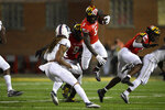 Maryland wide receiver Rakim Jarrett (5) carries the ball against Howard defensive back Rodney Dennard, center left, during the first half of an NCAA college football game, Saturday, Sept. 11, 2021, in College Park, Md. (AP Photo/Nick Wass)
