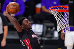 Miami Heat's Bam Adebayo (13) dunks during the second half in Game 6 of basketball's NBA Finals against the Los Angeles Lakers Sunday, Oct. 11, 2020, in Lake Buena Vista, Fla. (AP Photo/Mark J. Terrill)