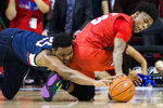 SMU guard Kendric Davis (3) and Connecticut center Josh Carlton (25) reach for a loose ball during the first half of an NCAA college basketball game Wednesday, Feb. 12, 2020, in Dallas. (Ashley Landis/The Dallas Morning News via AP)