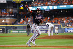 Washington Nationals' Adam Eaton celebrates after a home run off Houston Astros relief pitcher Josh James during the eighth inning of Game 2 of the baseball World Series Wednesday, Oct. 23, 2019, in Houston. (AP Photo/Matt Slocum)