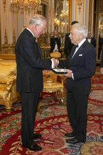 The Prince of Wales presents designer Ralph Lauren with his honorary KBE (Knight Commander of the Order of the British Empire) for Services to Fashion in a private ceremony at Buckingham Palace Wednesday June 19, 2019. (Victoria Jones/PA via AP)