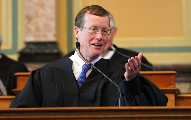 FILE - In this June 3, 2011, file photo, Iowa Supreme Court Justice Edward Mansfield speaks in Des Moines, Iowa. The Iowa Supreme Court on Thursday, Dec. 31, 2020, limited the legal damages that can be awarded for injuries and deaths caused by state police officers who are found to have used excessive force. Justice Mansfield wrote for the majority that compensatory damages for victims, including for emotional distress and attorney fees, would still be available and offer