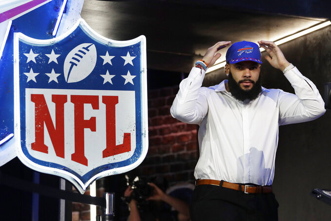 Oklahoma guard Cody Ford enters the stage after the Buffalo Bills selected him during the second round of the NFL football draft, Friday, April 26, 2019, in Nashville, Tenn. (AP Photo/Mark Humphrey)