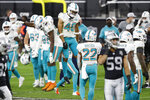 Miami Dolphins cornerback Noah Igbinoghene (23) and defensive back Nik Needham (40) celebrate after defeating the Las Vegas Raiders in an NFL football game, Saturday, Dec. 26, 2020, in Las Vegas. (AP Photo/Steve Marcus)