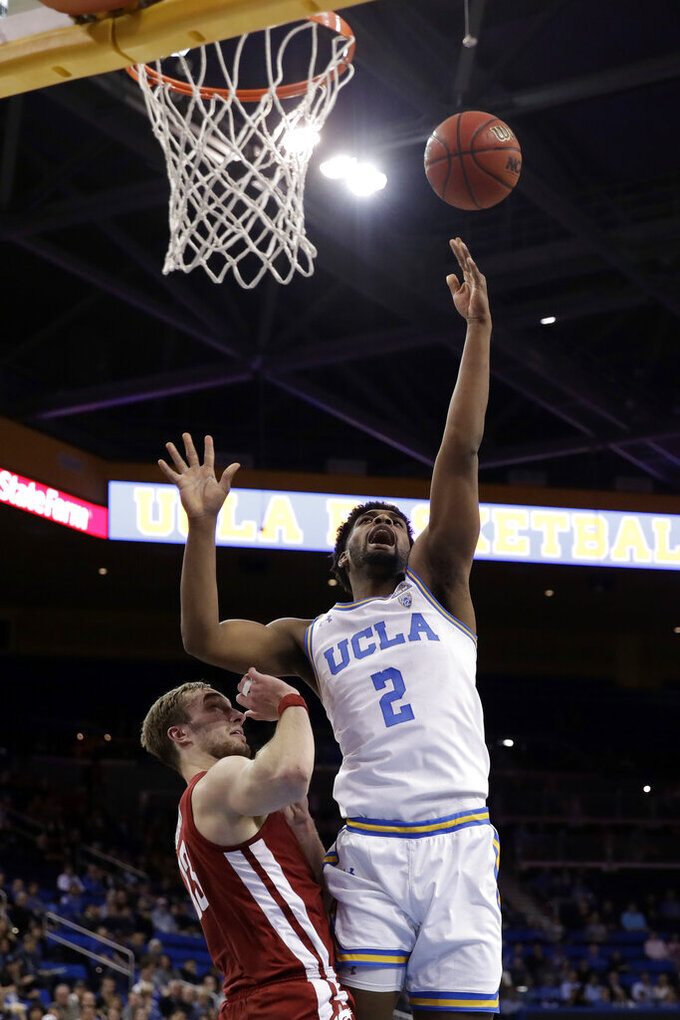 UCLA forward Cody Riley (2) shoots over Washington State forward Jeff Pollard during the first half of an NCAA college basketball game Thursday, Feb. 13, 2020, in Los Angeles. (AP Photo/Marcio Jose Sanchez)