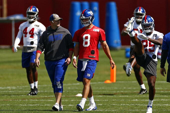 New York Giants quarterback Daniel Jones (8) talks with head coach Joe Judge during NFL football practice in East Rutherford, N.J., Thursday, May 27, 2021. (AP Photo/Adam Hunger)
