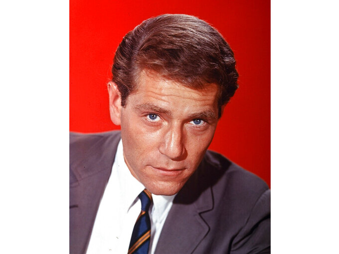 "Actor George Segal appears in a portrait from 1965.  Segal, the banjo player turned actor who was nominated for an Oscar for 1966's ""Who's Afraid of Virginia Woolf?,"" and starred in the ABC sitcom ""The Goldbergs,"" died Tuesday, his wife said. He was 87.  (AP Photo, File)"