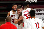Arizona forward Azuolas Tubelis (10) celebrates with teammates after tipping in a basket a the buzzer during the team's NCAA college basketball game against Arizona State, Thursday, Jan. 21, 2021, in Tempe, Ariz. Arizona won 84-82. (AP Photo/Rick Scuteri)