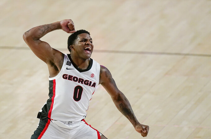 Georgia guard K.D. Johnson celebrates a dunk during the second half of the team's NCAA college basketball game against Missouri, Tuesday, Feb. 16, 2021, in Athens, Ga. (AP Photo/Brynn Anderson)