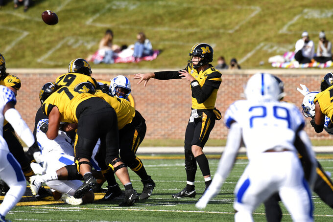 Missouri quarterback Connor Bazelak throws during the first half of an NCAA college football game against Kentucky Saturday, Oct. 24, 2020, in Columbia, Mo. (AP Photo/L.G. Patterson)
