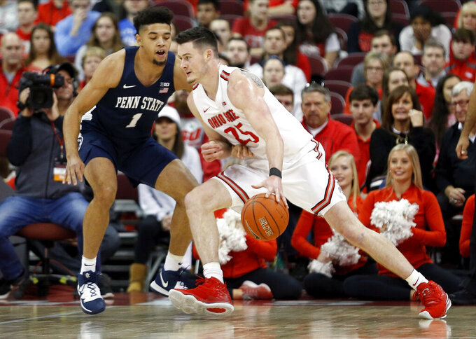 Ohio State's Kyle Young, right, drives to the basket against Penn State's Seth Lundy during the first half of an NCAA college basketball game Saturday, Dec. 7, 2019, in Columbus, Ohio. (AP Photo/Jay LaPrete)