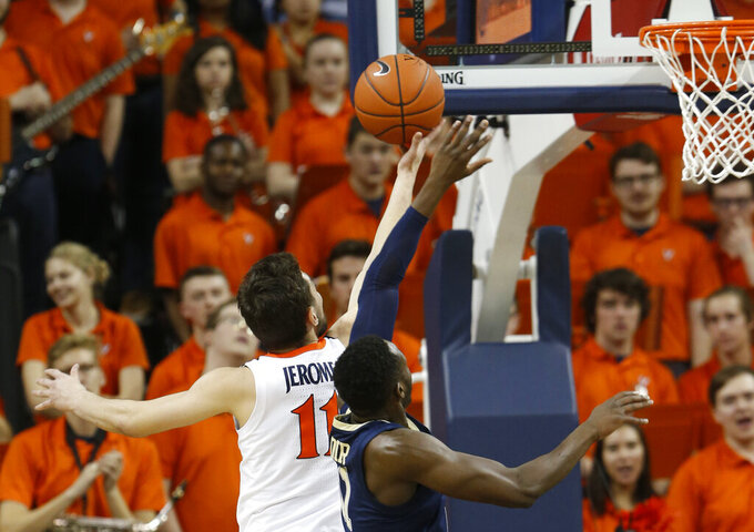 Virginia guard Ty Jerome (11) takes a shot over Pittsburgh guard Sidy N'Dir, right, during the first half of an NCAA college basketball game in Charlottesville, Va., Saturday, March 2, 2019. (AP Photo/Steve Helber)