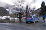 Media gather near a police car the place where a car had plowed into a group of people in Luttach, near Bruneck in the northern region South Tirol, Italy, Sunday, Germany, Jan. 5, 2020. Italian fire officials say a car has plowed into a group of young German tourists in northern Italy, killing ate least six people and injuring eleven. (AP Photo/Helmut Moling)