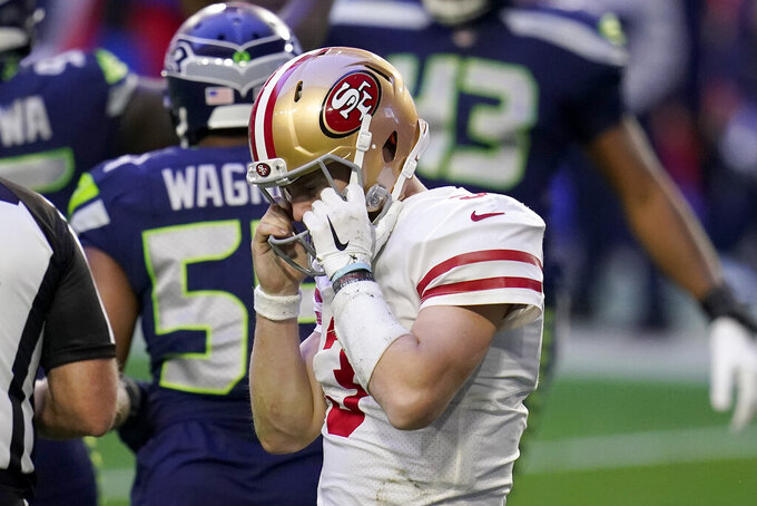 San Francisco 49ers quarterback C.J. Beathard (3) walks to the sidelines after being sacked against the Seattle Seahawks during the first half of an NFL football game, Sunday, Jan. 3, 2021, in Glendale, Ariz. (AP Photo/Ross D. Franklin)