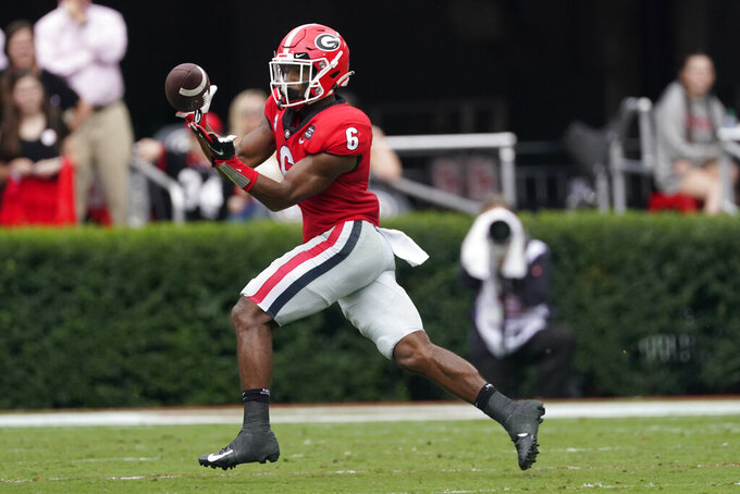 Georgia running back Kenny McIntosh (6) makes a catch to set up a touchdown in the first half of an NCAA college football game against Tennessee, Saturday, Oct. 10, 2020, in Athens, Ga. (AP Photo/John Bazemore)