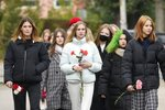 Students walk to lay flowers outside the Perm State University following a campus shooting in Perm, about 1,100 kilometers (700 miles) east of Moscow, Russia, Tuesday, Sept. 21, 2021. A student opened fire at the university, leaving a number of people dead and injured, before being shot in a crossfire with police and detained. Beyond saying that he was a student, authorities offered no further information on his identity or a possible motive. (AP Photo/Dmitri Lovetsky)