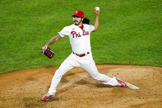 Philadelphia Phillies' JoJo Romero pitches during the seventh inning of a baseball game against the Washington Nationals, Monday, Aug. 31, 2020, in Philadelphia. (AP Photo/Matt Slocum)