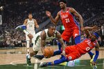 Milwaukee Bucks' Eric Bledsoe is called for a charge on Philadelphia 76ers' Josh Richardson during the first half of an NBA basketball game Saturday, Feb. 22, 2020, in Milwaukee. (AP Photo/Morry Gash)