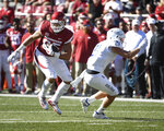 Arkansas tight end Cheyenne O'Grady, left, makes a catch in front of Tulsa defender Bryson Powers in the first half of an NCAA college football game Saturday, Oct. 20, 2018, in Fayetteville, Ark. (AP Photo/Michael Woods)