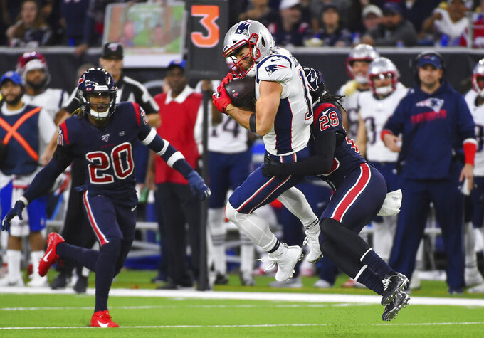 New England Patriots wide receiver Julian Edelman (11) is hit by Houston Texans cornerback Vernon III Hargreaves (28) as he makes a catch during the first half of an NFL football game Sunday, Dec. 1, 2019, in Houston. (AP Photo/Eric Christian Smith)