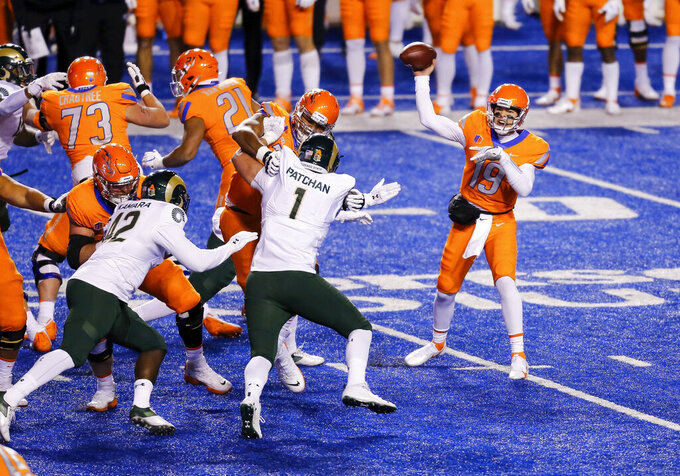 Boise State quarterback Hank Bachmeier (19) throws a pass as Colorado State defensive lineman Scott Patchan (1) rushes during the first half of an NCAA college football game Thursday, Nov. 12, 2020, in Boise, Idaho. (AP Photo/Steve Conner)