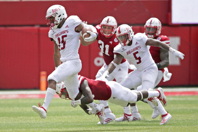 Nebraska safety Marquel Dismuke, bottom, tackles South Alabama wide receiver Kawaan Baker (15) during the second half of an NCAA college football game in Lincoln, Neb., Saturday, Aug. 31, 2019. Nebraska won 35-21. (AP Photo/Nati Harnik)