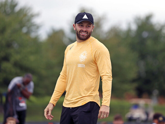 Cleveland Browns quarterback Baker Mayfield is introduced at the Baker Mayfield ProCamp in Gates Mills, Ohio, Wednesday, July 21, 2021.(Joshua Gunter/Cleveland.com via AP)