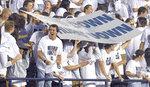 Utah State students brave the rain during a lightning delay before an NCAA college football game against North Dakota, Friday, Sept. 10, 2021, in Logan, Utah. (Eli Lucero/The Herald Journal via AP)