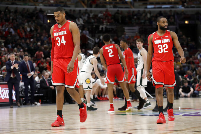 Ohio State's Kaleb Wesson (34) and Keyshawn Woods (32) react during the second half of an NCAA college basketball game against Michigan State in the quarterfinals of the Big Ten Conference tournament, Friday, March 15, 2019, in Chicago. (AP Photo/Nam Y. Huh)