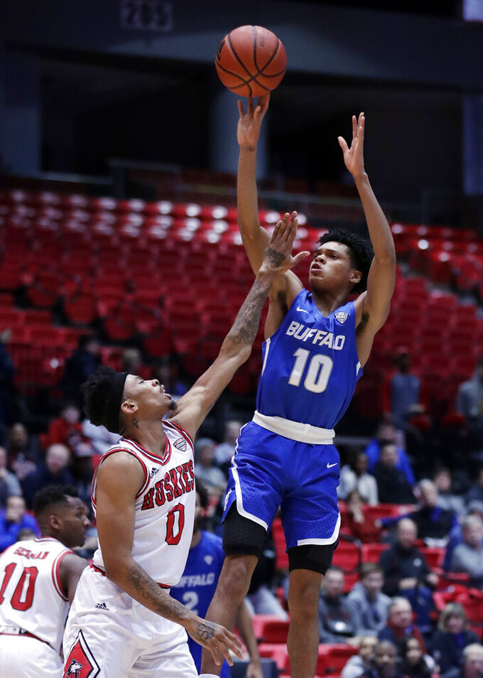 Buffalo guard Ronaldo Segu, right, shoots Northern Illinois guard Dante Thorpe guards during the first half of an NCAA college basketball game Tuesday, Jan. 22, 2019, in DeKalb, Ill. (AP Photo/Nam Y. Huh)