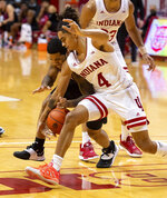 Indiana guard Khristian Lander (4) steals the ball away from Penn State guard Sam Sessoms (3) during the first half of an NCAA college basketball game, Wednesday, Dec. 30, 2020, in Bloomington, Ind. (AP Photo/Doug McSchooler)