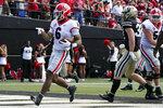 Georgia running back Kenny McIntosh (6) scores a touchdown against Vanderbilt in the second half of an NCAA college football game Saturday, Sept. 25, 2021, in Nashville, Tenn. Georgia won 62-0. (AP Photo/Mark Humphrey)