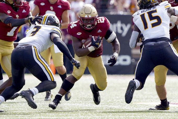 Boston College running back Pat Garwo III (24) rushes through Missouri defenders during the second half of an NCAA college football game, Saturday, Sept. 25, 2021, in Boston. (AP Photo/Mary Schwalm)